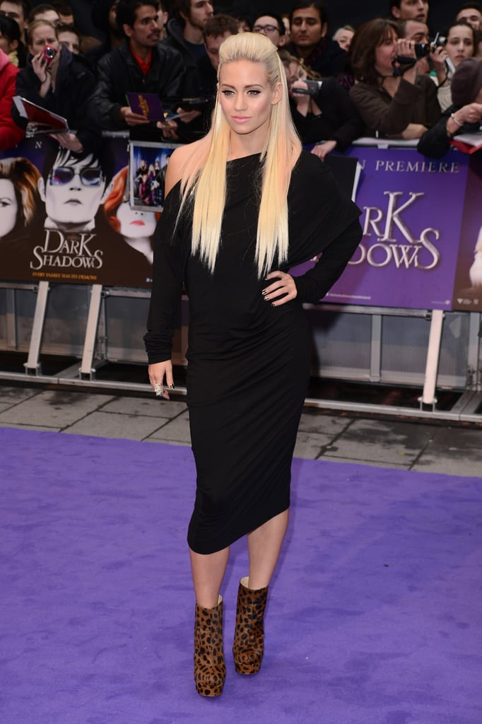 Kimberly Wyatt teamed a black dress with print ankle boots.