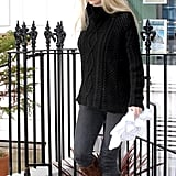 Gwyneth Paltrow Wearing a Black Cable Knit Sweater