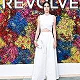 Amelia Gray Hamlin wearing wide-leg Melissa Bui trousers and a knotted tee at the Revolve Festival party.