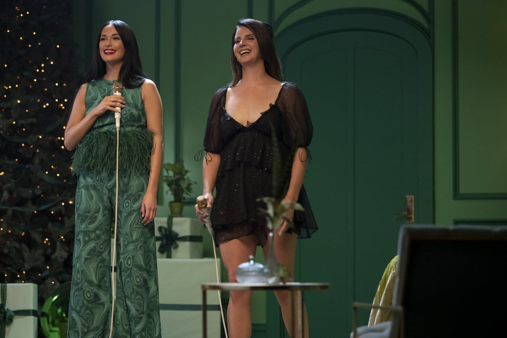 """Kacey Musgraves and Lana Del Rey joined forces for a beautiful rendition of """"I'll Be Home For Christmas,"""" and it's giving us chills. As part of the country singer's new Amazon Prime Video special, The Kacey Musgraves Christmas Show, the duo sang the holiday classic on stage together. While Musgraves looked quite festive in a green outfit and red lipstick, Del Rey wore a little black dress and her signature updo. From the dreamy scenery to their angelic voices, the cover will make you want to wrap yourself in a warm blanket and sit by the fire with a cup of hot cocoa.       Related:                                                                                                           10 New Christmas Albums to Celebrate the Most Wonderful Time of the Year"""
