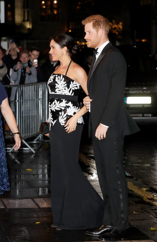 Another day, another glamorous date night. On Monday, Prince Harry and Meghan Markle looked absolutely stunning as they stepped out for the Royal Variety Performance in London, an annual televised event that benefits UK musicians in need. While Harry looked dashing in a black tux, it was his wife that really stole the spotlight in a long black skirt and sequined halter top.  The couple has had their fair share of fun date nights lately. In addition to getting all dolled up for Prince Charles's 70th birthday bash at Buckingham Palace, the duo recently reunited with Prince William and Kate Middleton to attend Royal Foundation Dinner at Victoria House in London. We can't get enough of their sweet moments together.