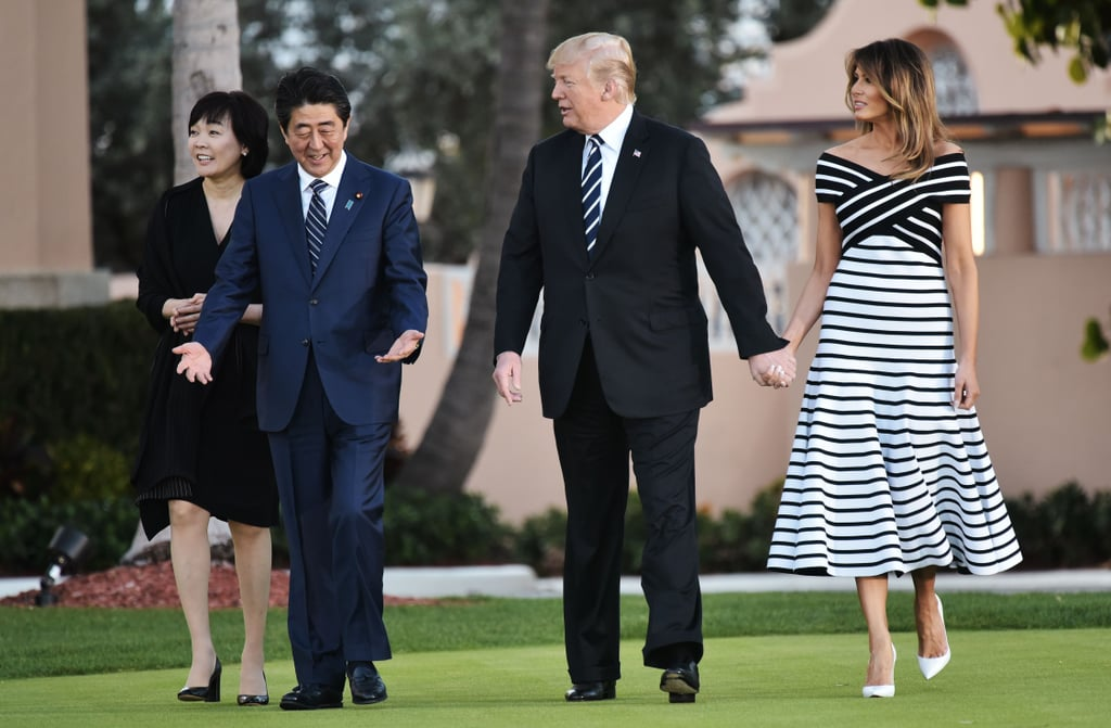Call it accidental twinning, but Melania's Carolina Herrera dress just so happened to match the stripes on President Donald Trump's tie as they held hands. The duo walked with Japan's Prime Minister Shinzō Abe and wife Akie Abe to dinner at Trump's Mar-a-Lago resort in Palm Beach, Florida on April 17.