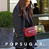 Katie Holmes carried a red purse.