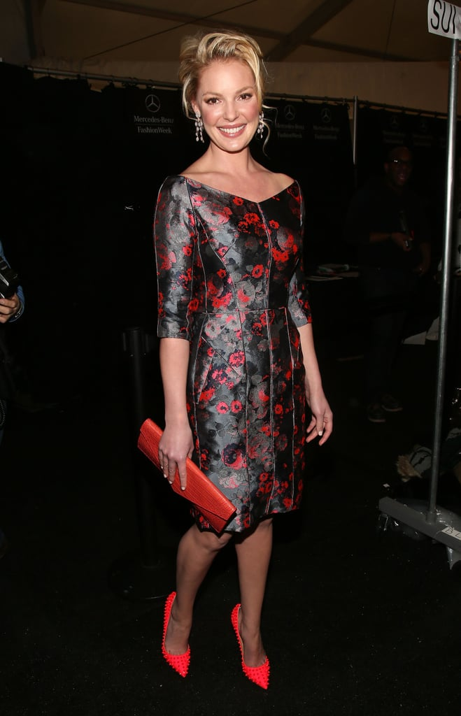 Katherine Heigl blossomed in a floral jacquard confection, coral pumps, and a crocodile clutch, all by J. Mendel, at the designer's Fall 2013 show.