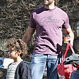 Hugh Flexes His Biceps While Carrying Kiddie Bags