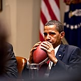 Clutching a football in 2009.