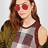Illesteva Wynwood Ii Round-Frame Metal Mirrored Sunglasses ($175), because they'll get you noticed and score you compliments.