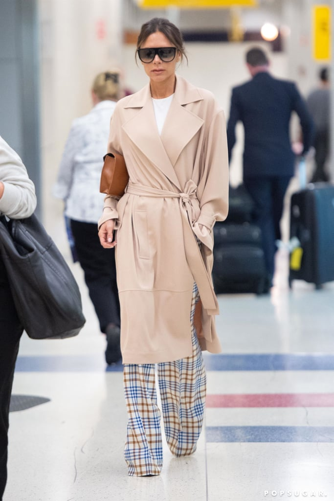 Victoria Beckham in Trench Coat and Plaid Pants