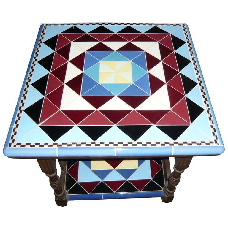 This Original Art Deco Geometric Tile Table ($2,800) has a repeat of blues, burgundy, black, and checkerboard design and dates back to the 1930s.