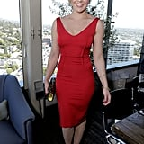 Abbie Cornish wore a red knee-length dress with cap-toe pumps and a Jimmy Choo clutch at the daytime event.
