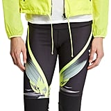 Try layering your tank with a lightweight jacket, like this one. Alo Yoga Sunset Nylon Jacket W/ Mesh Inset, Highlighter ($68, originally $98)
