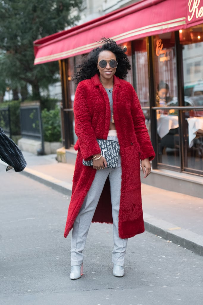 Take your cosy later to the next level by opting for red outerwear instead of classic black, brown, or navy.
