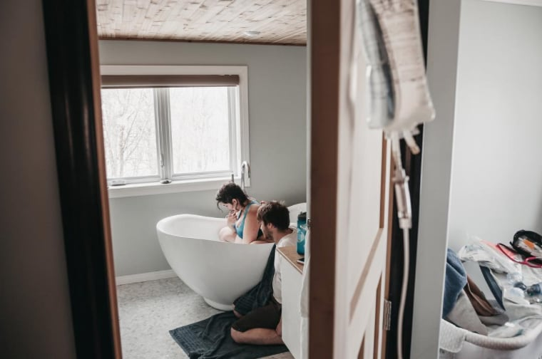 This mom's birth photographer snapped a jaw-dropping photo as she labored in the bathroom.