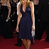 At the 2003 Emmy Awards, Jennifer opted for a navy cocktail dress with a low neckline.