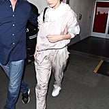 Wearing a casual tracksuit and white sneakers.