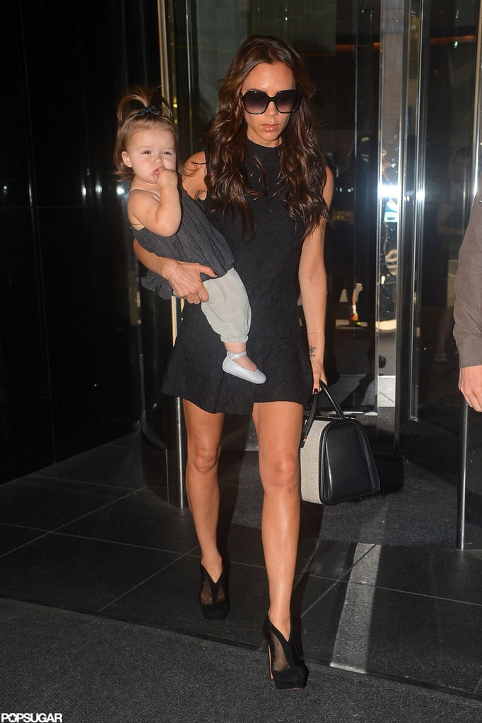 Victoria Beckham carried Harper Beckham out of their NYC hotel.