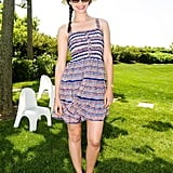 To ring in the Fourth of July, Emmy Rossum picked a striped sundress, navy-trimmed hat, and bare feet. Source: Joe Schildhorn /BFAnyc.com