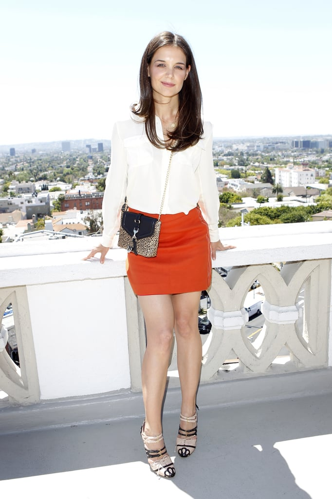 Katie Holmes sprung forward yesterday at a lunch for Ann Taylor held in the penthouse of LA's Chateau Marmont. Katie was named as the face of the brand a few months ago, and she appears in the Spring 2011 ads. Her deal with the retailer was the latest in a string of endorsements — she's also working with John Frieda and has teamed up with Valextra. Katie, of course, is most dedicated to her own label, Holmes & Yang, which she spent a good portion of March showing off with trunk shows in NYC and the West Coast. Katie has lately been spending lots of time with newly 5-year-old daughter Suri and husband Tom Cruise, who just picked up a new part as a scandal-prone politician. First, though, Tom is playing the role of an honoree, as he's accepting an honor from the anti-Nazi group organization, the Simon Wiesenthal Center Museum of Tolerance on May 5.