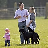 Peter, Autumn, and Savannah Phillips With the Family's Black Lab