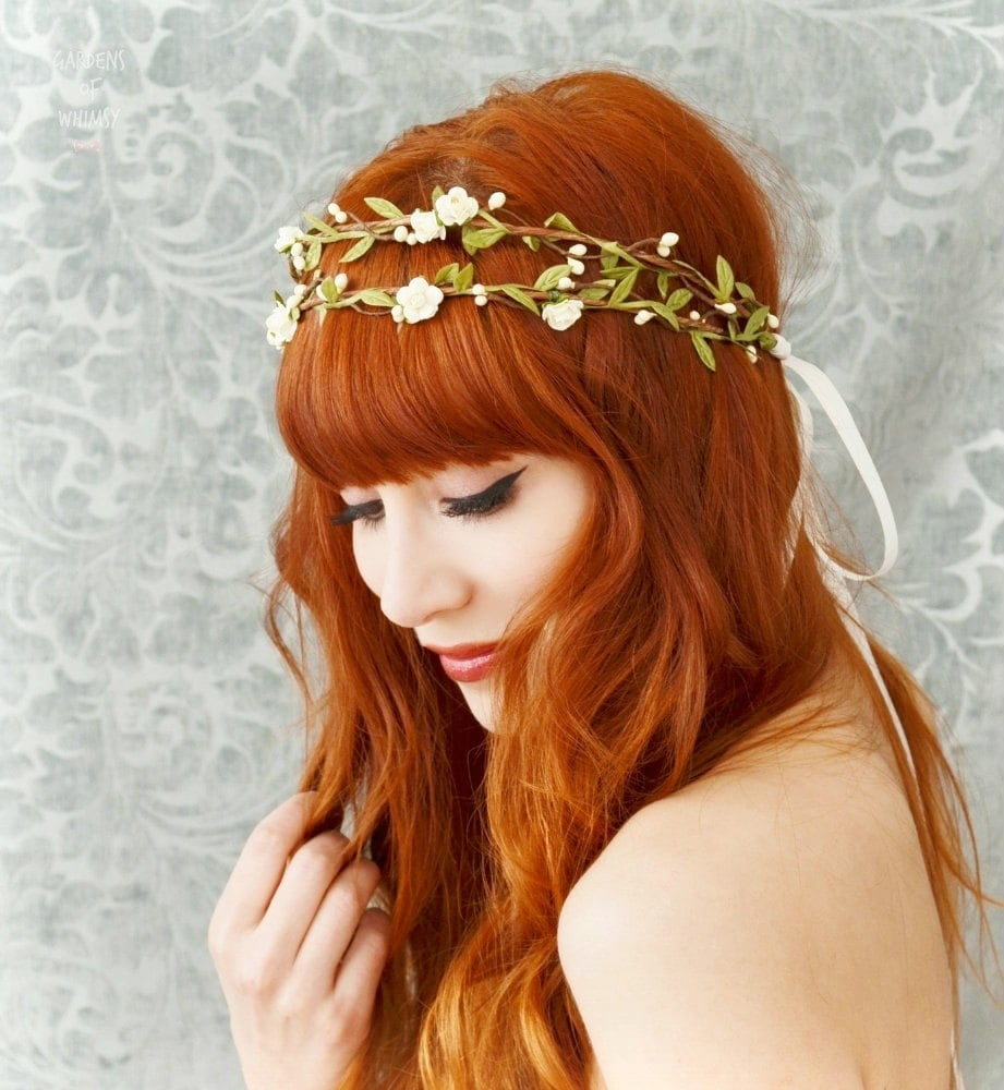 Wrap a floral hair wreath ($65) around flowing waves for a bohemian wedding theme.