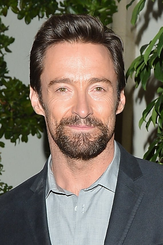 Hugh Jackman sported a scruffy beard.