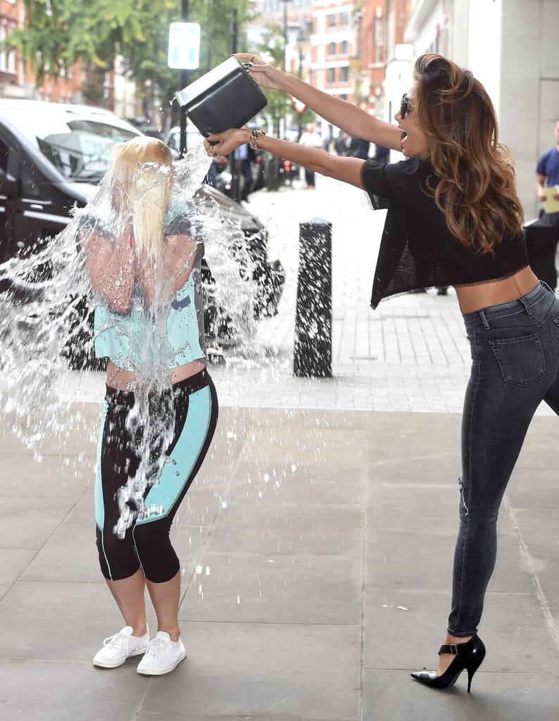 On Tuesday, Nicole Scherzinger had the honors of helping a fan take the Ice Bucket Challenge outside the BBC Radio One studio in London.