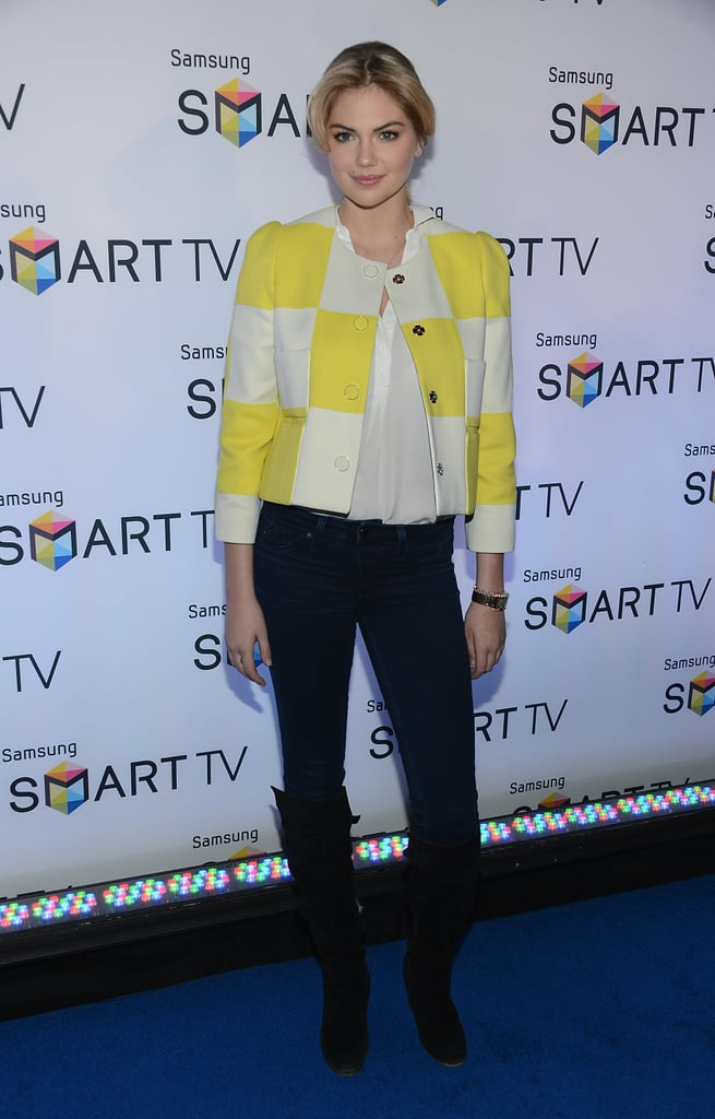 Kate Upton punched up her black jeans and white blouse with Louis Vuitton's yellow-and-white cropped collarless checkered jacket at an event in NYC.