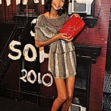Chanel Iman can't help but show off her 2.55 bag.
