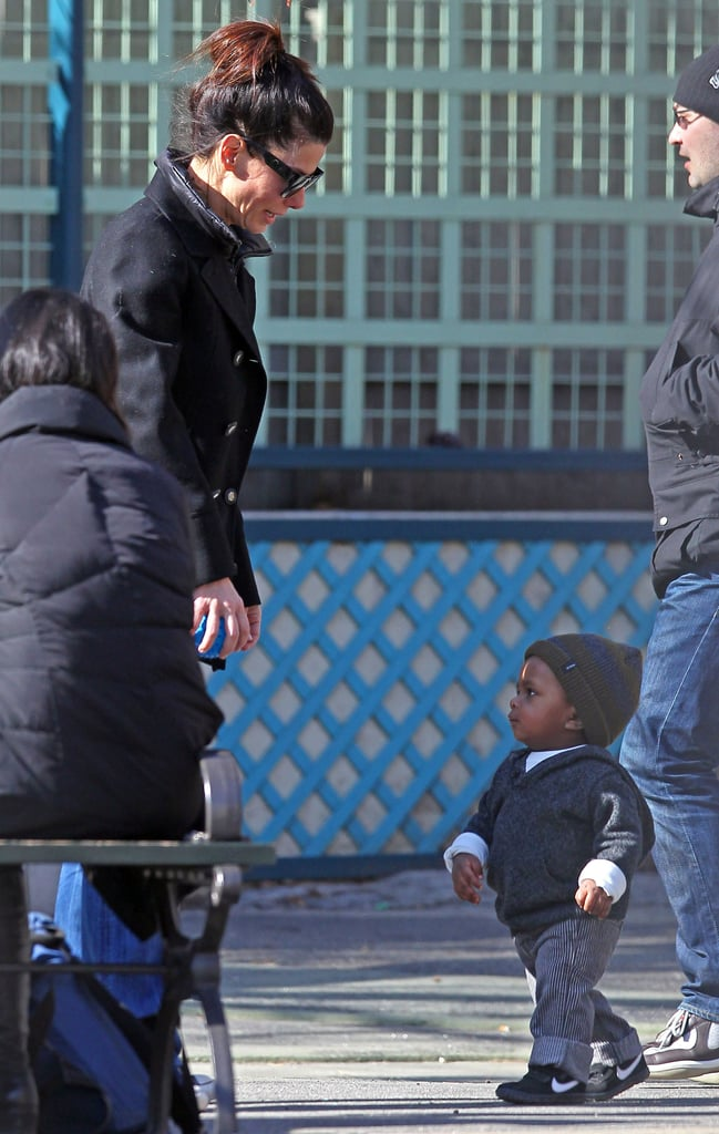 Sandra Bullock had a proud mom moment as her son Louis showed off his walking skills at a park in Manhattan yesterday. It's been almost a year since she introduced him to the world and since then Louis has been her partner in crime everywhere she goes. For now, the twosome are hanging out in New York where she is shooting Extremely Loud and Incredibly Close with costar Tom Hanks. Sandra's been hard at work on the movie and her character necessitates a much lighter wig, but between takes she's all about cuddling up to her little man, and she also makes sure to donate big bucks to causes close to her heart.