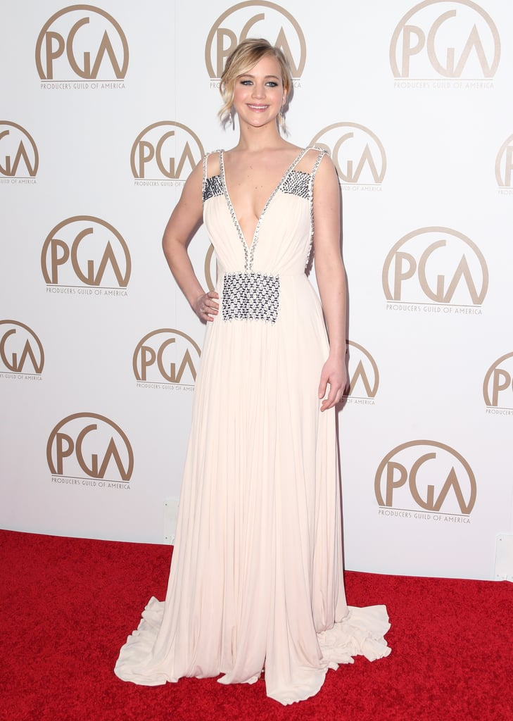 Jennifer Lawrence stole the spotlight when she stepped out for the Producers Guild Awards in LA on Saturday. Wearing a gorgeous floor-length gown and a huge smile, the actress posed for pictures ahead of the show, looking stunning as she showed off the back of her dress. The event marked Jennifer's first red carpet moment in a couple months, but she recently made headlines, thanks to her charming interview with Eddie Redmayne, who also attended the Producers Guild Awards. Check out all the best pictures of Jennifer's night out!