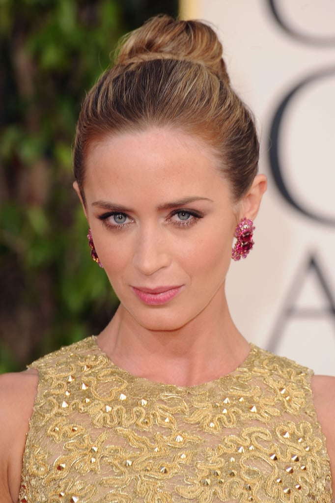 Emily Blunt wore a gold gown to the Golden Globes.
