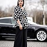 If black pants feel boring, swap for a voluminous pair instead.