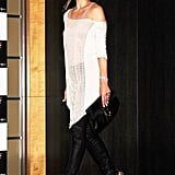While Milla Jovovich's silky ascot look was chic, this shredded tee ensemble is super rock 'n' roll.