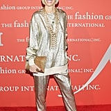 Bergdorf Goodman's Linda Fargo also went for sparkle but instead chose a gold sweater and trousers for the occasion.