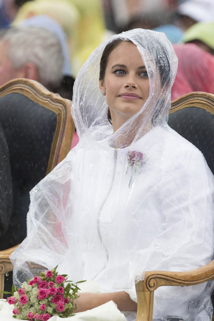A little rain does not ruin either of their royal photo ops!