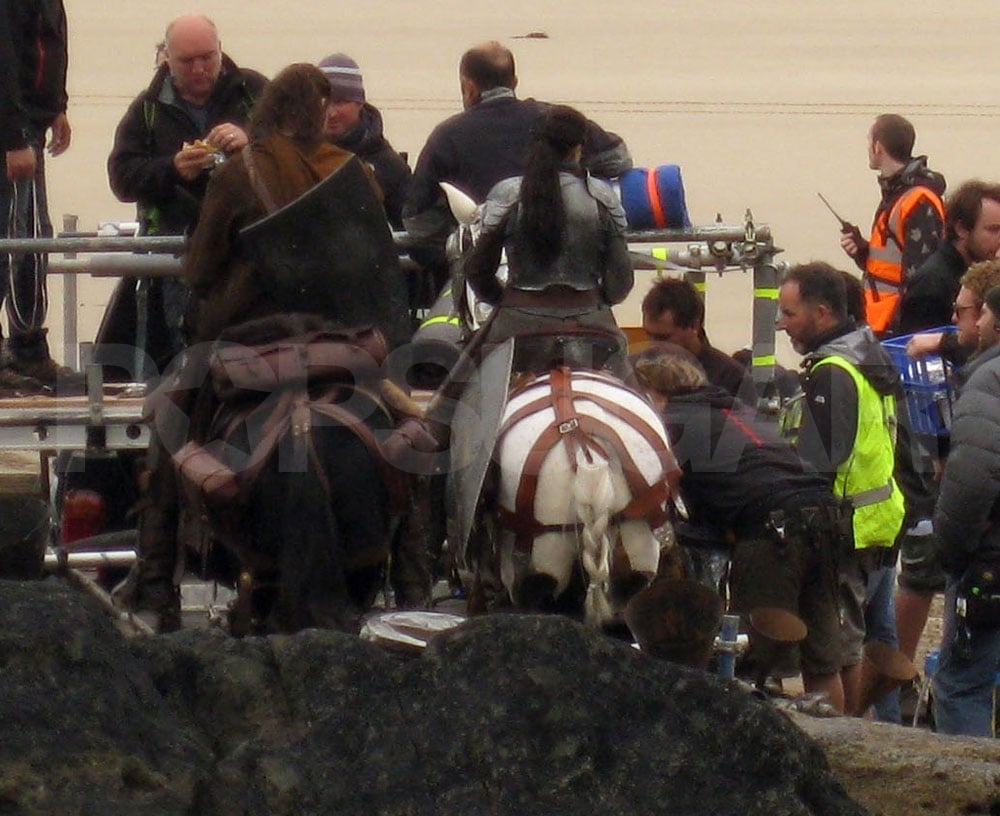 Kristen Stewart atop a horse while on the Snow White and the Huntsman set.