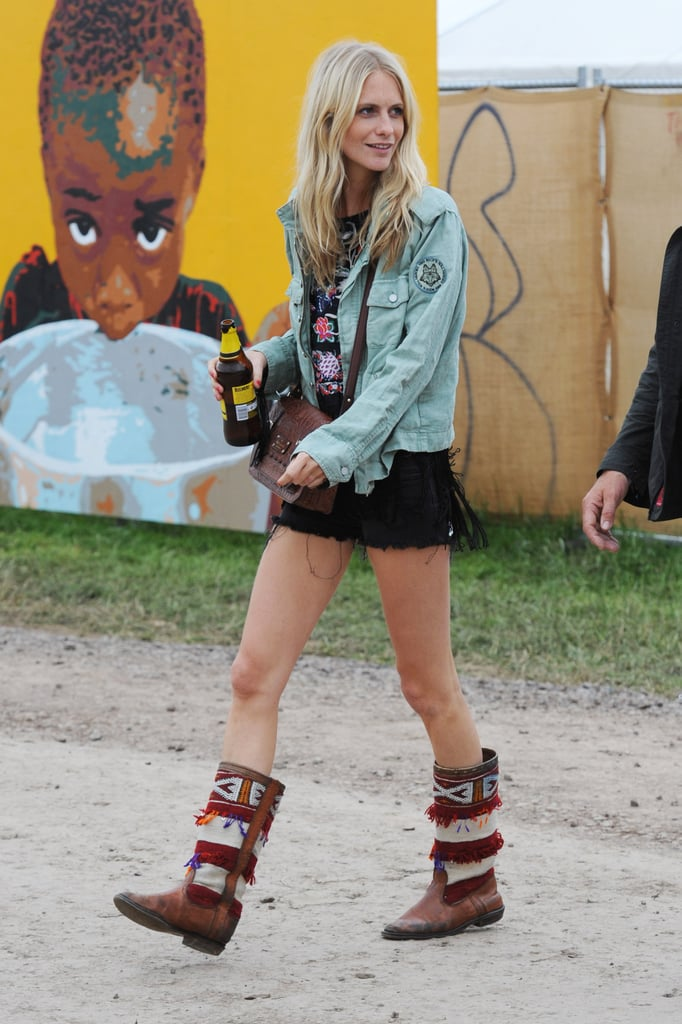 Poppy Delevingne skipped ultra-bright hues like sister Cara in favour of a light denim jacket, embellished boots, and a Kate Spade crossbody we've seen before.
