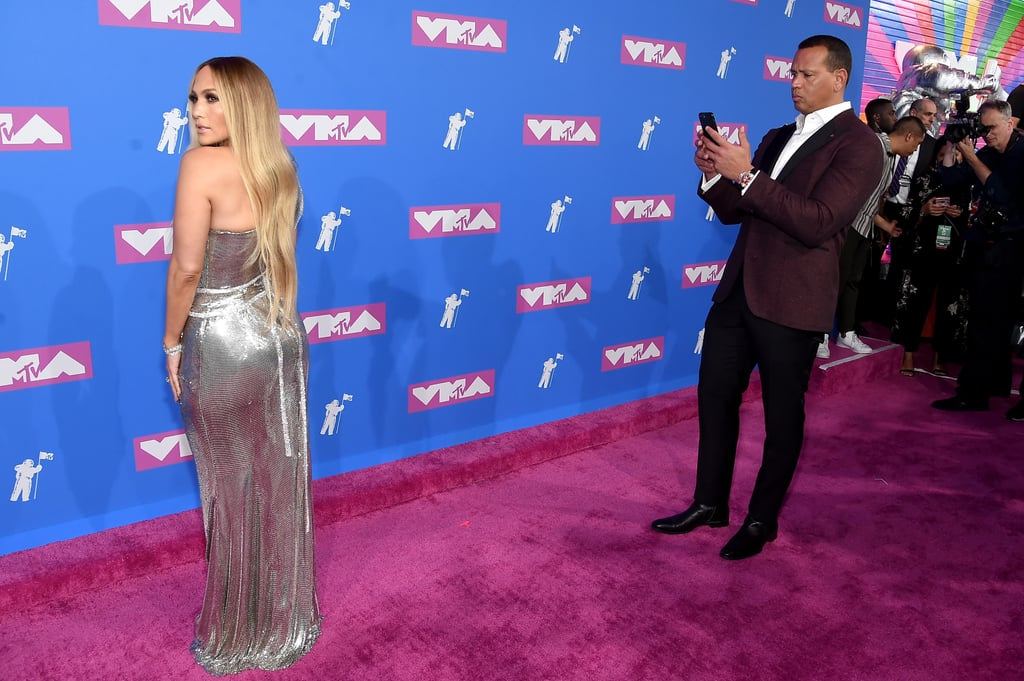 Remember when Alex Rodriguez was caught taking photos of Jennifer Lopez at the 2017 Met Gala? Well, he's at it again, but at the 2018 VMAs this time. The baseball star snapped photos of his girlfriend on the red carpet at Radio City Music Hall before heading inside to the event. Considering it's a huge night for Jennifer, it's no wonder the couple looked like they were ready to get crowned king and queen of the night in their fabulous outfits.  Jennifer is not only performing, but she's also receiving the prestigious Michael Jackson Video Vanguard Award. She is the first Latinx artist to do so in the 36 years of the award's history, so needless to say it's a special night for the duo. Keep reading to see just how adorable Jennifer and Alex looked on the red carpet.      Related:                                                                                                           As Usual, Jennifer Lopez Makes Sultry Look Effortless on the VMAs Carpet