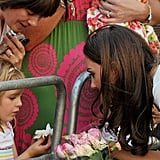 Kate talks with a little girl.