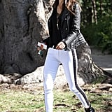 Alessandra Ambrosio's white tuxedo jeans were the star of her LA ensemble, but her leather biker jacket and Christian Louboutin buckled boots lent oomph.