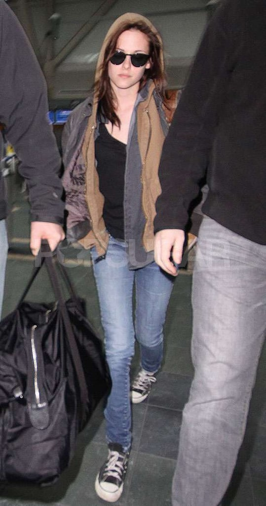 Kristen Stewart touched down in Canada yesterday to resume filming Breaking Dawn. She's still sporting a splint on her wrist, but that didn't get in the way of good times during her stay in LA. The actress reportedly let loose on the dance floor with Robert Pattinson at Chateau Marmont on Friday night. Kristen and Robert were both spotted arriving in Vancouver a week ago, as was their onscreen daughter Mackenzie Foy. We were hoping to see Rob at the Oscars last night, but the Twilight surprise turned out to be an auto-tuned movie montage.