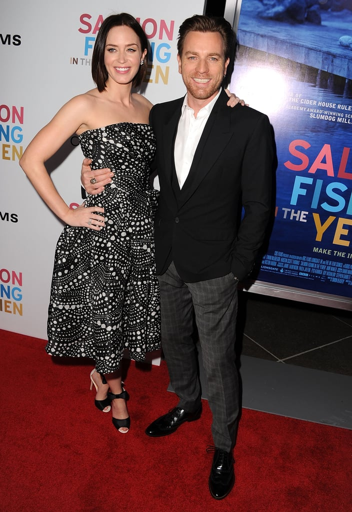 Ewan McGregor and Emily Blunt teamed up for the premiere of their film Salmon Fishing in the Yemen last night at the Directors Guild of America in Hollywood. Emily paired a tea-length Naeem Khan dress with Chopard jewels at the debut while Ewan suited up in Dolce & Gabbana. Her husband, John Krasinski, wasn't on hand to pose for pictures with her, but Ewan's wife Eve Mavrakis joined him on the red carpet for a few photos. Ewan and Emily costar in the new movie as a team tasked with bringing the sport of fishing to the middle of a sheik's Yemeni desert. The film, which comes from the screenwriter of Slumdog Millionaire and the director of Chocolat, opens this Friday. The feel-good story will be Emily's last big-screen foray until The Five-Year Engagement opposite Jason Segel. That comedy will give the actress the chance to show off her humorous side when it hits theaters this Spring.
