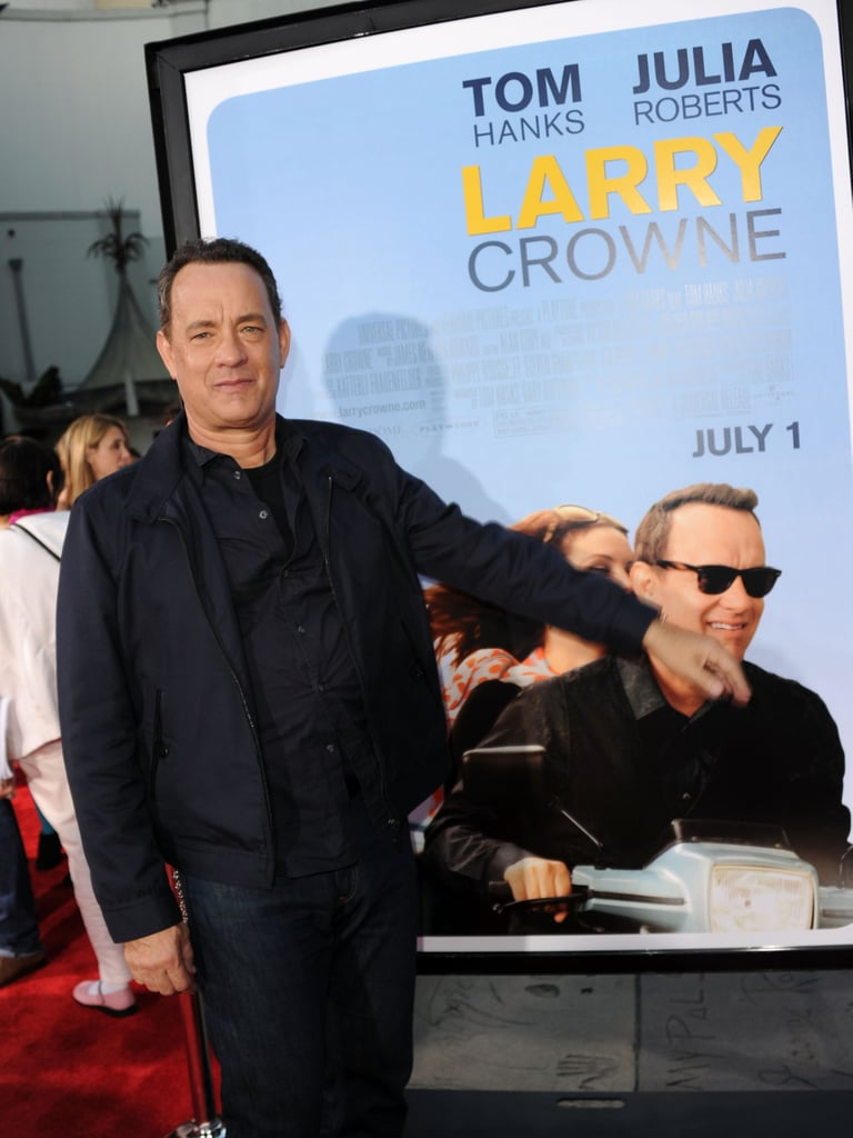 Tom Hanks shows off his Larry Crowne poster.