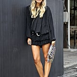 Breezy, all-black pieces feel distinctly summery, especially with aviators and a thigh-high hemline.