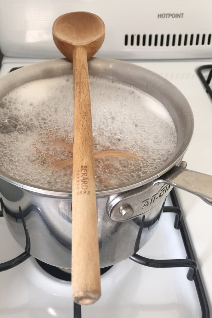 Place a wooden spoon over the top of the pot to prevent the water from boiling over.