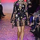Hailey Baldwin in the Elie Saab Spring '17 dress during Paris Fashion Week.