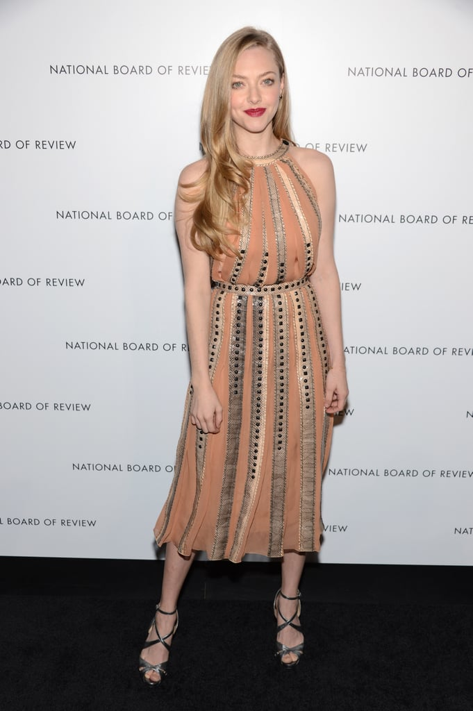 Amanda Seyfried opted for a feminine Bottega Veneta halter-style midi dress, then finished with loose waves, red lips, and crisscross heels.