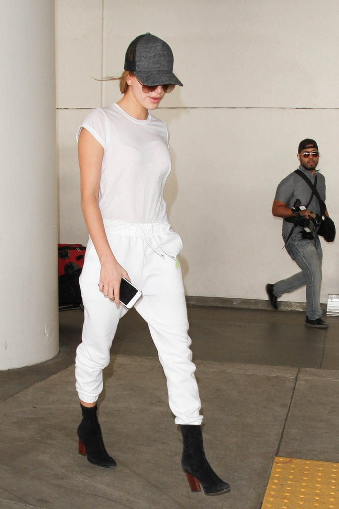 Hailey Baldwin instantly turned her white tee and joggers outfit into something street style worthy with a pair of black booties.