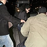 Kristen Stewart traveled in a black hoodie.