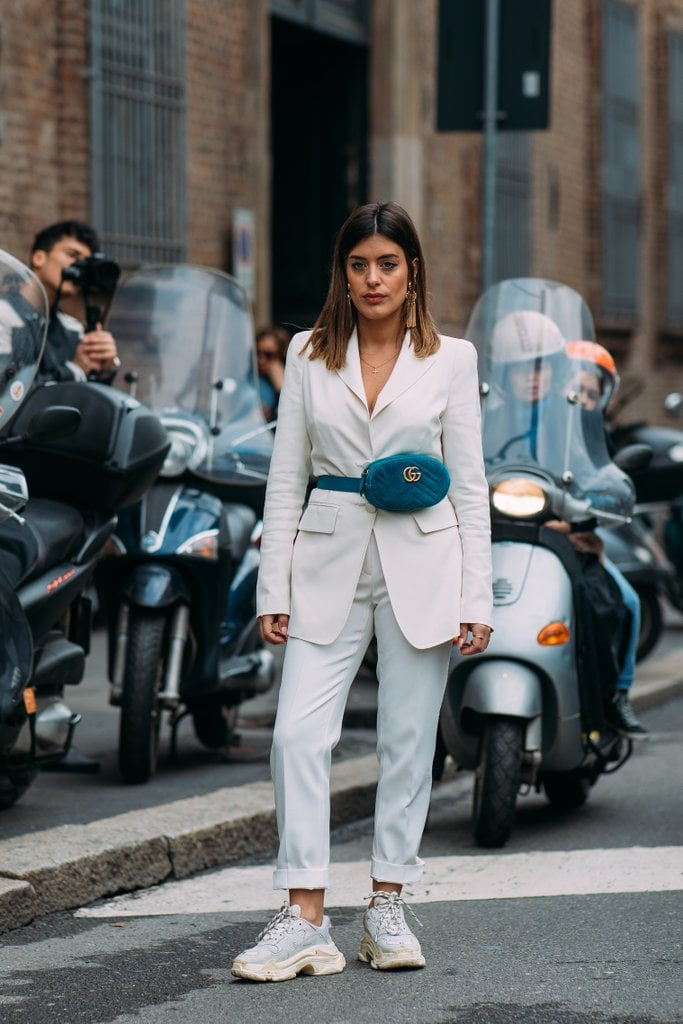 Break up an all-white ensemble with a blue Gucci fanny pack.